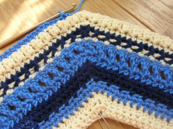 Handmade crochet yolk for Icelandic crochet cardigan in blues and cream.