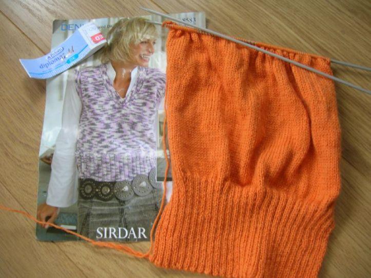 Orange knitting for sweater vest from sirdar pattern