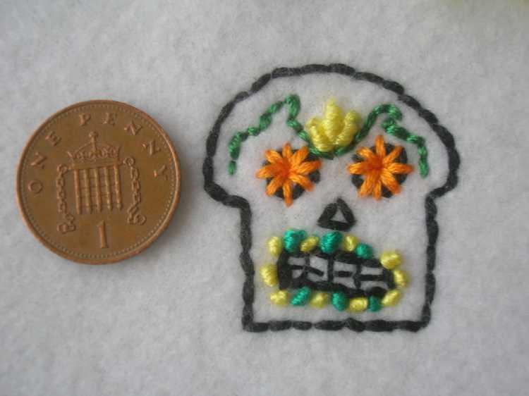Handmade embroidered fleece skull for day of the dead