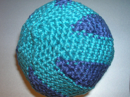 Handmade crochet hacky sack in turquoise and blue. Made with cotton 4-ply yarn and filled with dried mung beans.