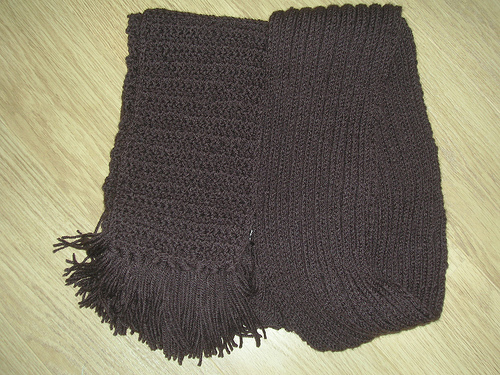 Two brown handmade scarves in knit and crochet.
