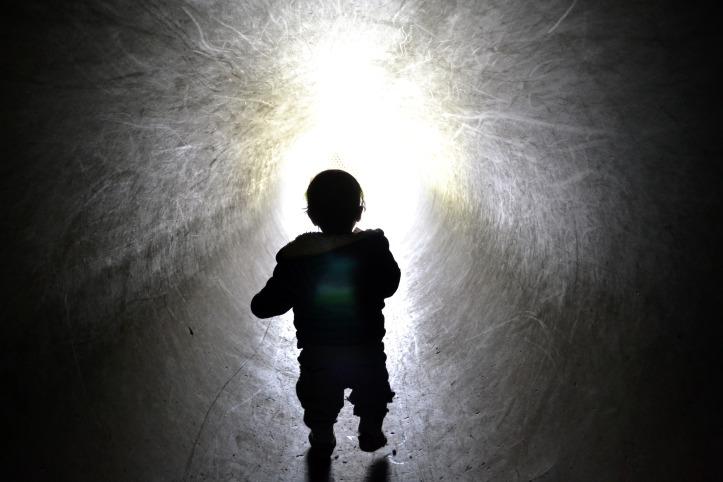 Toddler in tunnel at Auchengarrich Wildlife Park