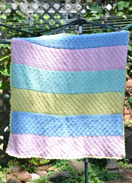 crochet baby blanket on clothes line