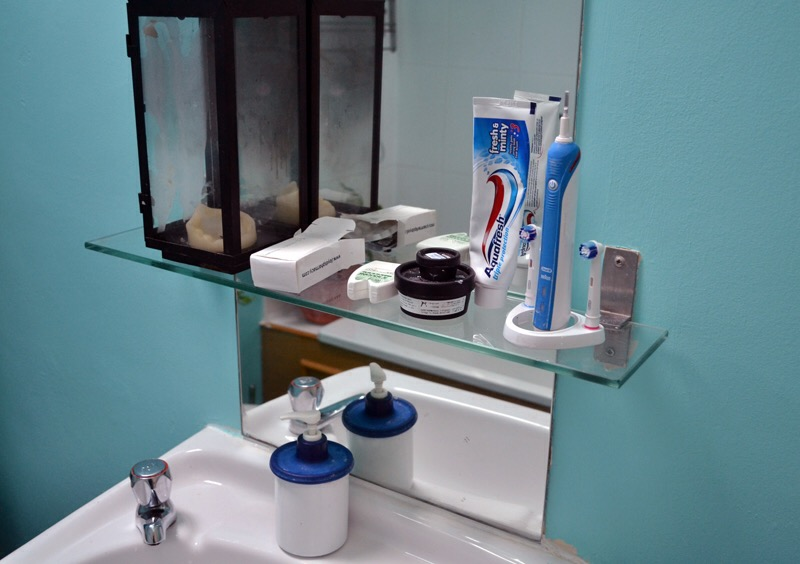 newly painted bathroom. simplified toiletries