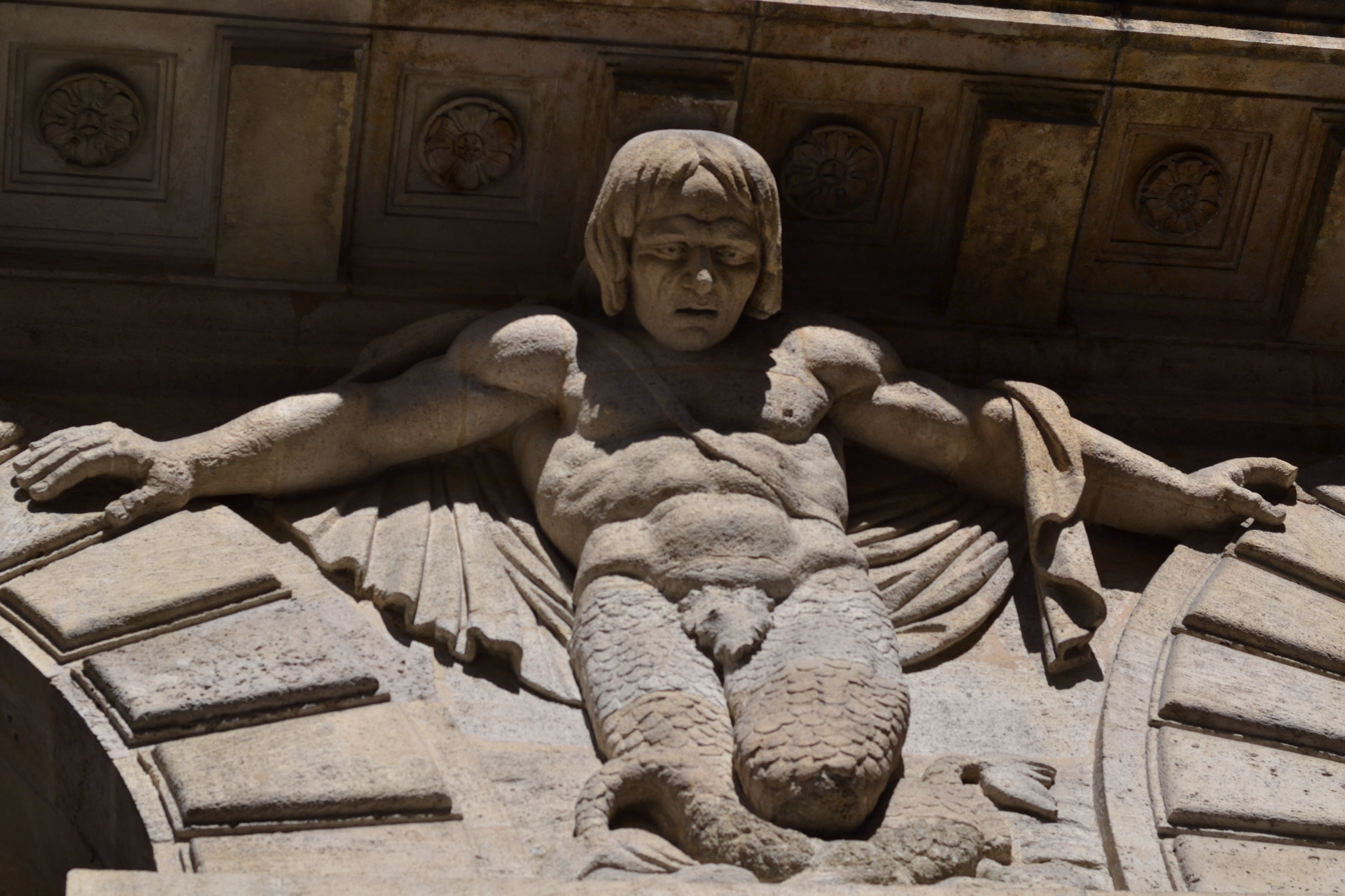 Merman sculpture Bordeaux France building