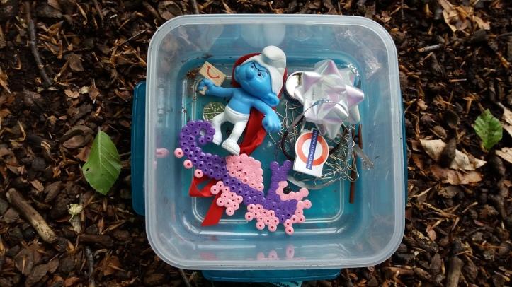 Grumpy Smurf in a geocache box found in the forest: Mine Woods, Bridge of Allan, Scotland
