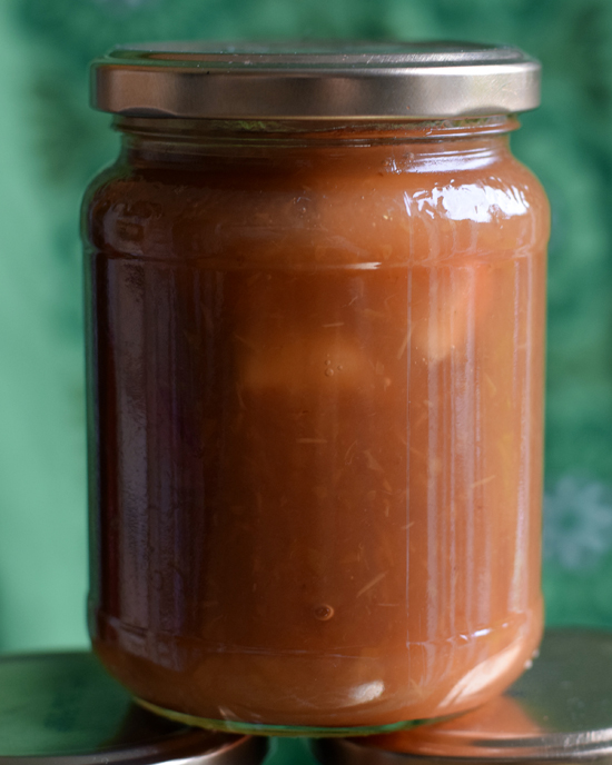 Glass jar with traditional apple jam made with sugar and foraged apples from around Stirling, Scotland.