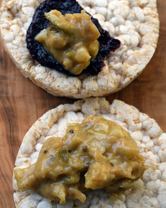 Homemade fermented Indian lime pickle on rice cakes with homemade garden blackberry jam.