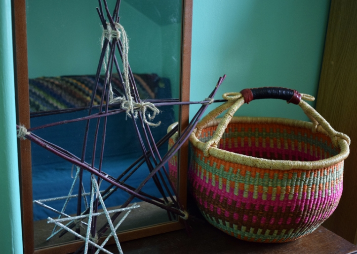 Ghanaian market basket, stick stars and mirror on dresser in room with new green walls. | Riotflower's Realm